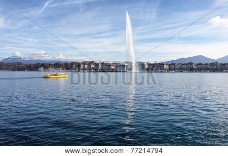 Lake Geneva Switzerland With Water Fountain And Water Taxi On A Nice Autumn Day