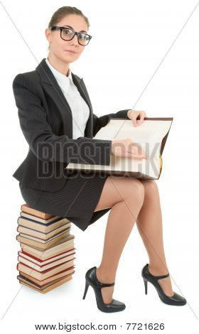 Woman And A Pile Of Books