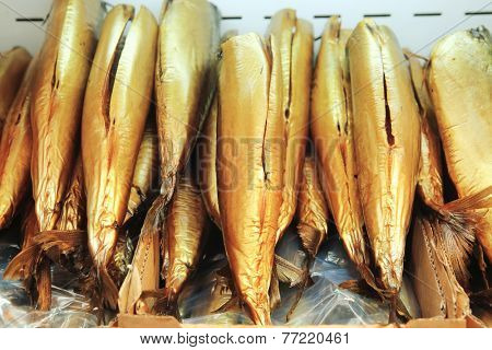 smocked norvegian fish mackerel on plate on market
