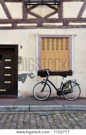 Bike Parked In Front Of A Rustic House