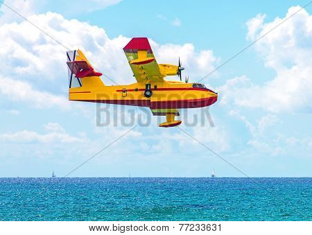 Aerial Firefighting.  Aircraft Preparing To Collect Sea Water