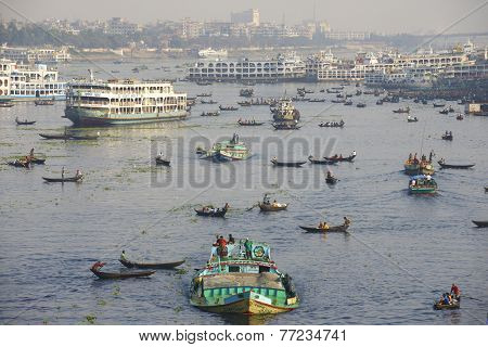 DHAKA BANGLADESH - FEBRUARY 21: Residents of Dhaka cross Buriganga river by boats on February 21 201