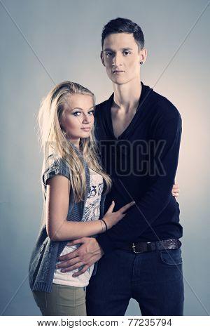 Loving Couple Posing In Studio
