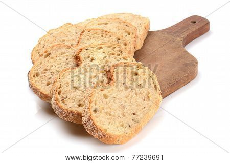 Sliced Loaf Of Bread On A Cutting Board Isolated On White