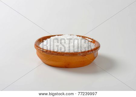 brown ceramic bowl of grained salt