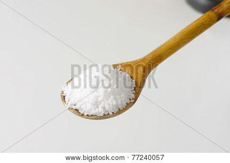 portion of sea salt on the wooden spoon