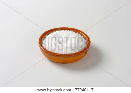 portion of salt in the ceramic brown salt cellar