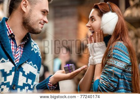 Man making proposal to girlfriend in the cafe