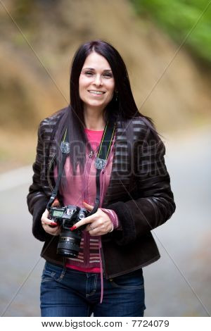 Young Lady With Photo Camera