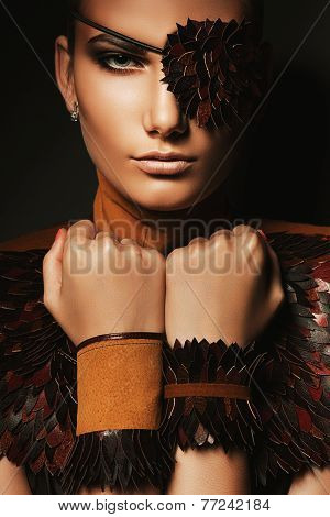 Portrait Of Woman With Eyepatch And Bracelets