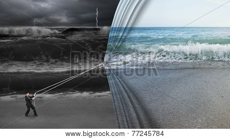 Businessman Pulling Open Calm Sea Curtain Covered Dark Stormy Ocean