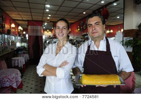 Small Business: Female Owner Of A Cafe And Waiter