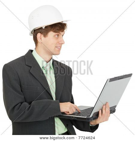 Smiling Engineer In Helmet With Laptop In Hands