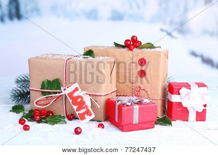 Beautiful Cristmas gifts with European Holly (Ilex aquifolium) on nature background