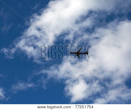 Silhouette Of Airplane In The Sky