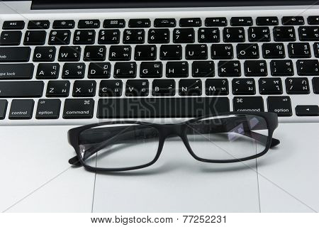 Blank Business Laptop, Mouse And Glasses
