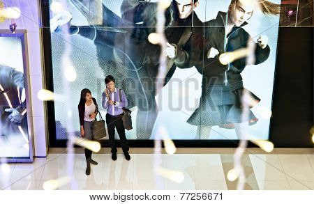 Young Couple Doing Xmas Shopping In A Mall