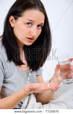 Woman Preparing To Take Pill