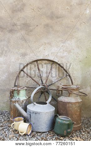 Rustic scene with wagon wheel