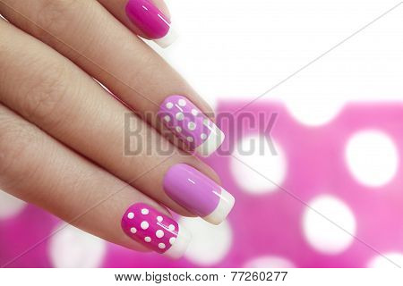 Nail design with white dots .