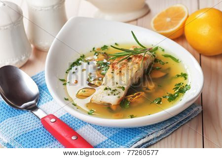 Sea food soup with grilled cod fish steak