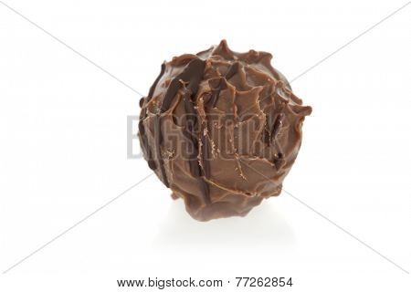 Gourmet chocolate truffle isolated on white background