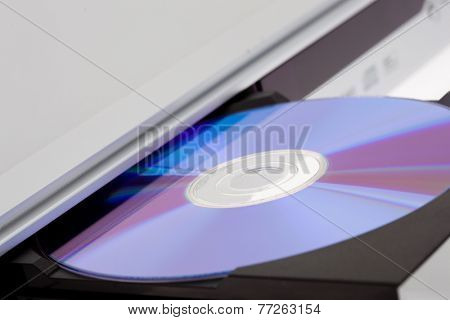 Close up of a DVD player ejecting disc