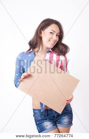 Cute Smiling Girl With A Sign In Hands