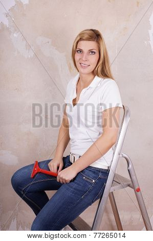 woman sitting on ladder