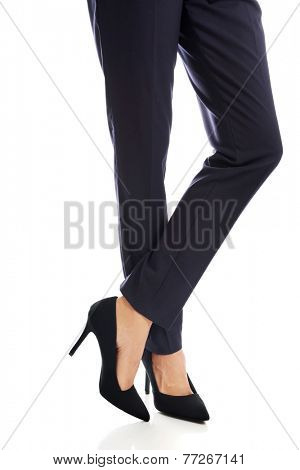 Close up on businesswoman slim legs in high heels.