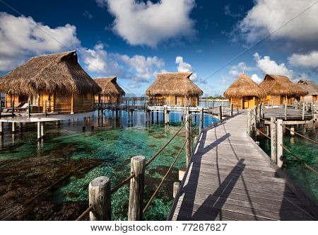 small houses on water in the ocean