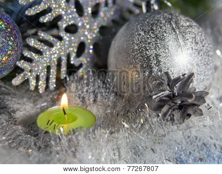 Silvery New Year's ball and candle