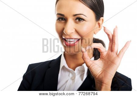 Businesswoman showing ok sign, looking at the camera