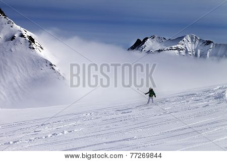 Snowboarder Downhill On Off-piste Slope With Newly-fallen Snow