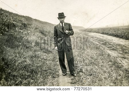 GERMANY, CIRCA 1920s: Vintage photo of man in hat outdoor