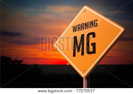 MG on Warning Road Sign.