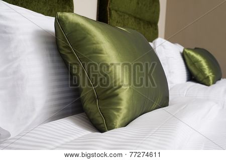 Cushions , Green pillows on bed