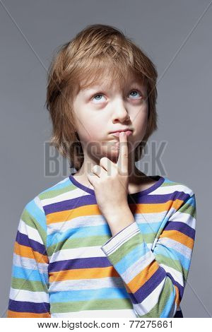 Boy Looking Thinking, Finger On His Mouth