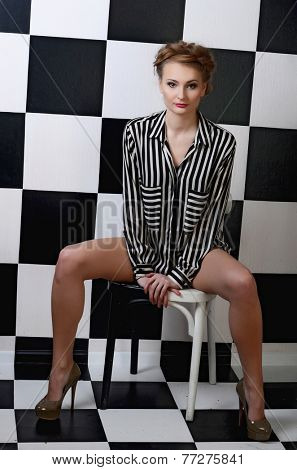 The beautiful woman on a chess background