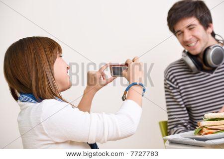 Students - Happy Teenage Couple Taking Photo With Camera