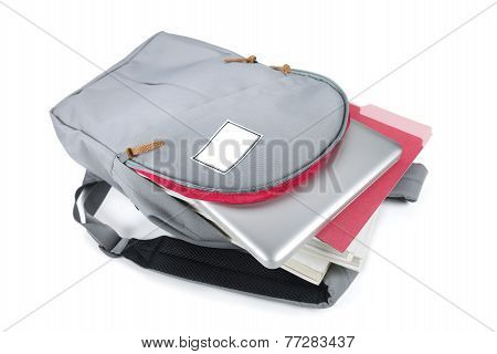 backpack with a laptop on a white background