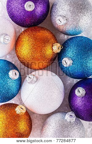 Top of view multicolored christmas balls.