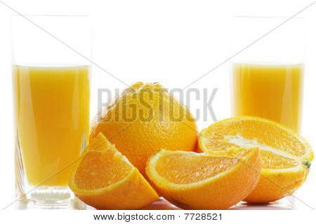 Oranges And Two Glasses Of Juice