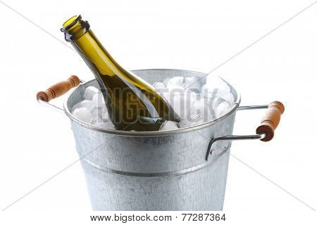 Bottle of champagne in metal ice bucket isolated on white