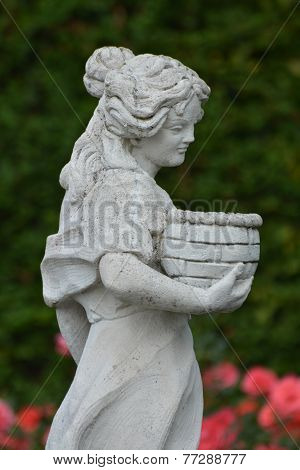 Rose Garden With Woman Sculpture
