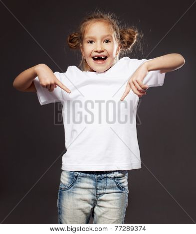 Child in white t-shirt. Girl on gray background
