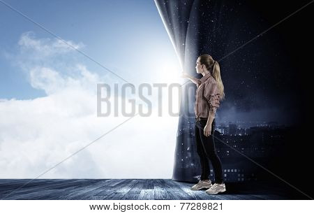 Young woman in casual opening stage curtain