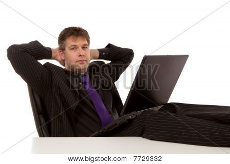 Businessman Is Sitting Relaxed
