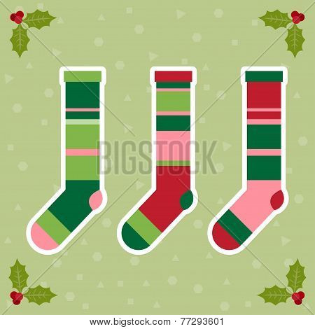 Winter Holidays Background With Colorful Baby Socks For Gifts From Santa Claus And  Branch Of Holly