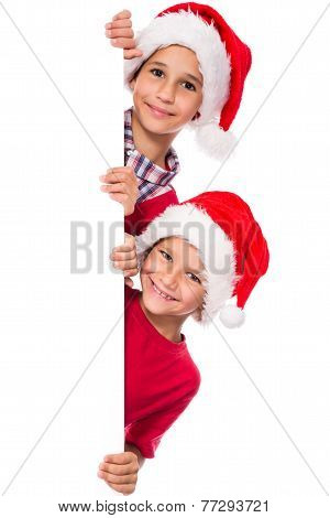 Kids in Santa hat with whiteboard